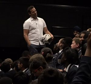 Dan speaking in a visit to a school.