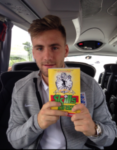"Manchester United left-back Luke Shaw with his copy of ""Skills from Brazil"""